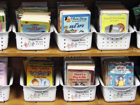 Baskets of books await young readers.