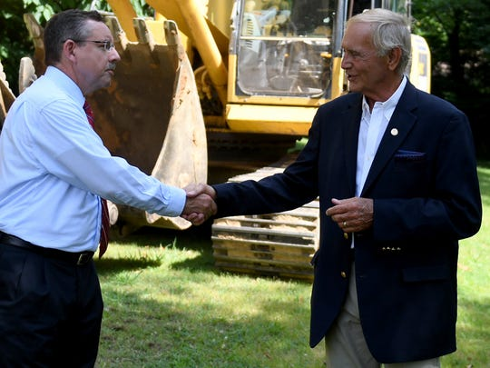 Ralph Perrey, Executive Director for the Tennessee Housing Development Agency, shakes hands with Jackson City Mayor Jerry Gist before the demolition of the vacant house located at 133 W. Deaderick Street, Wednesday, July 12. The demolition is part of THDA's Blight Elimination Program.