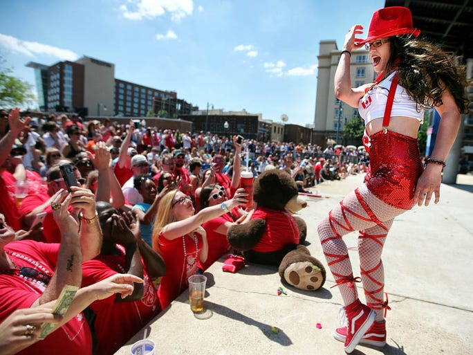 April 24, 2016 - Lacey Holsenbeck from the Blind Bear competes in the Queen of the Vine pageant, part of the Beale Street Merchant Association's annual Great Wine Race festivities. Restaurants and bar employees from across the city participated events like The Queen of the Vine,  grape stomping, and the namesake wine race which started up just in time to cheer downtrodden Grizzlies fans Sunday afternoon.