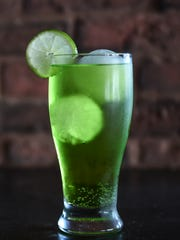 Similar to a Long Island, a Tokyo tea retains the vodka, gin, and light rum. The asian influence kicks in when triple sec is replaced with melon liqueur such as Midori, and the cola in replaced with lemon-lime soda.