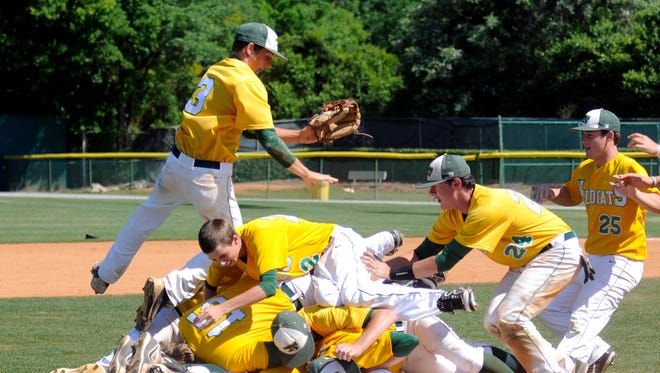 Edgewood celebrates after winning their sixth straight  AISA Class A state championship at Paterson Field in Montgomery, Ala., on Tuesday, May 6, 2014.