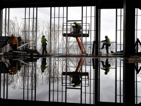 Workers with Vannoy Construction continue the metal framing of the 30,000-square-foot Mission Health outpost facility under construction on Hospital Drive near Clyde in early January.