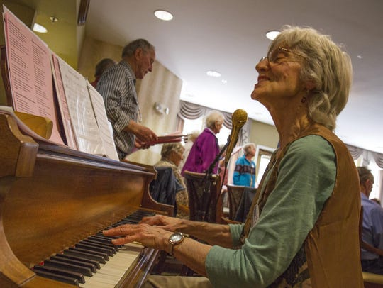 Pianist Sharon Kunka emcees a performance by the Swinging