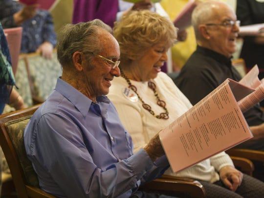 Highgate Senior Living resident Cecil Murphy (center)