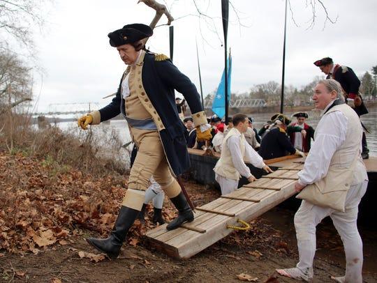 John Godzieba, portraying Gen. George Washington, walks