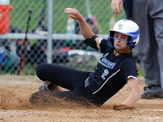 Lampeter Strasburg's Hanna Garber slides into home plate to score at Donegal High School in Mt. Joy on Monday, May 9, 2016.