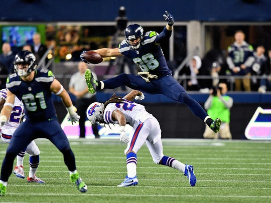 Seahawks tight end Jimmy Graham leaps to avoid a tackle against Buffalo this season. Graham is also entering the final year of his contract.