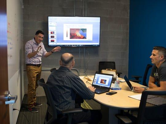 Esteban Ibarra (left) talks during a meeting at Ingenu on May 25, 2017, in Scottsdale.