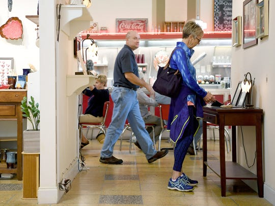 Ann Spearman, visiting from Huntsville for a tennis tournament, right, looks over things for sale at the Woolworth Walk on Thursday, Sept. 14, 2017. As the leaves start to change the downtown gallery and lunch counter will start to see a major increase in business.