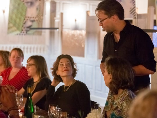 Lady of the House manager and beverage director Christian Stachel explains a wine pairing to former Food and Wine magazine editor Dana Cowin at an August 3rd Salonniere dinner at Lady of the House, which opens to the public September 20.