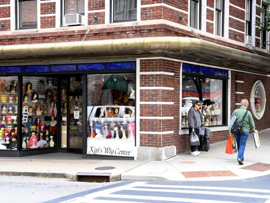 Kim's Wig Center has sat on the corner of Haywood Street and Battery Park Avenue for almost 45 years. In December the store will close so the current owner can retire and will be replaced with a beer-only taproom.