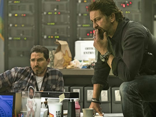 "Maurice Compte (left) and Gerard Butler star in ""Den"