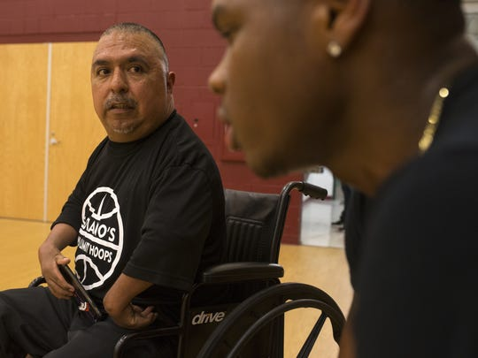 David Solano, left, talks with Malik Wallace during Solano's No Limit Hoops at Raul H. Castro Middle School.