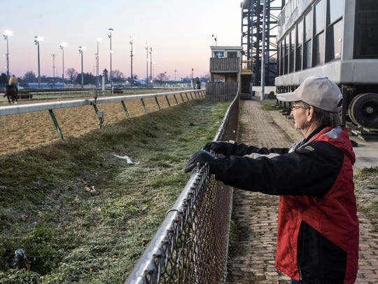 Hall of Fame jockey and Christ Church Chapel volunteer Pat Day watches morning workouts at Churchill Downs at sunrise on a Wednesday morning. 4/11/18
