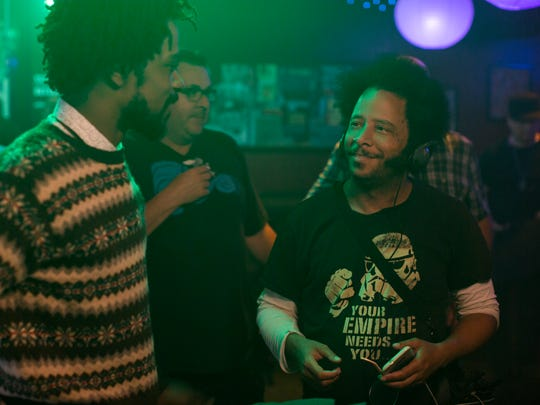 Boots Riley (right) directs Lakeith Stanfield on the