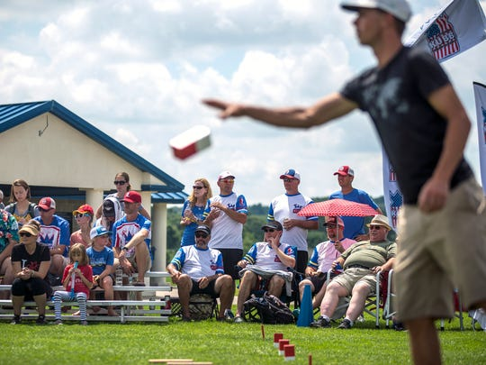 Spectators watch the semifinal matches during the U.S. National Kubb Championship in Eau Claire, Wis., July 15, 2018.