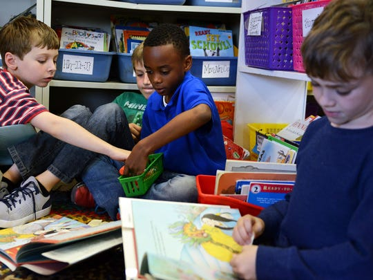 Second graders in teacher Jessica Roberts' class prepare for a reading lesson at Francine Delany New School For Children last week.