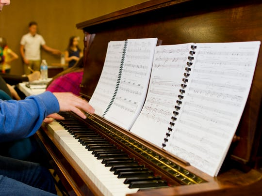"""Pianist Steve Olson accompanies the cast at Miss Linda's School of Dance as they work through a rehearsal of Disney's """"Beauty and the Beast."""""""