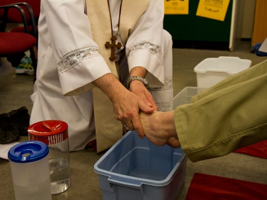 Bishop Michael Warfel washes the feet of one of one