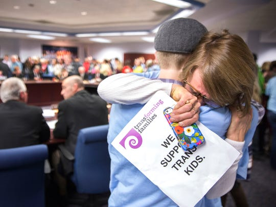 Janae Winegarden of Maple Grove hugs her transgender son Seth Thompson, 17, to celebrate after the Minnesota State High School League board voted in 2014 to pass the Model Gender Identity Participation in MSHSL Activities Policy.