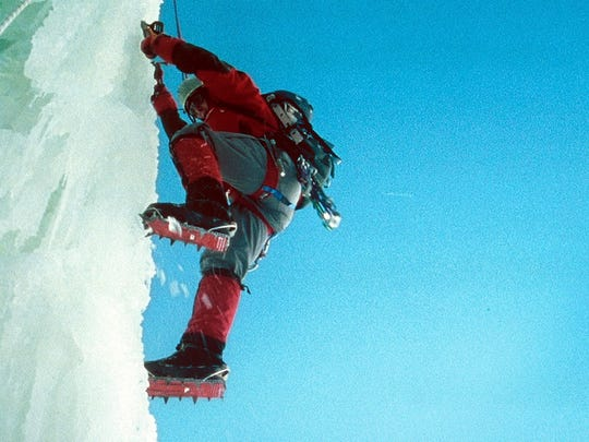 "Nicholas Aaron (Simon Yates) crawls across the moraine in ""Touching the Void"" (2003)."