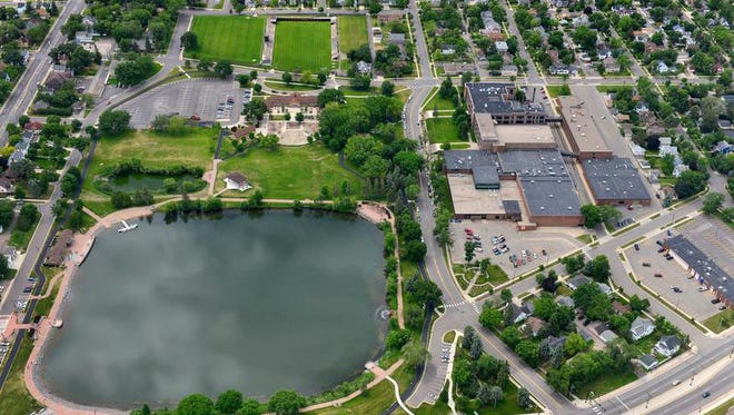 The district owns three properties near Lake George, including Clark Field pictured at top, Technical High School to the right, and a media services building at the bottom right.
