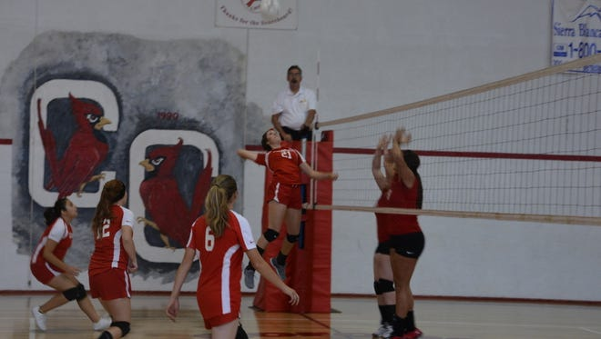Corona High School's Aubrey Brandenberger slams the ball over the net in a recent home game against Carrizozo.
