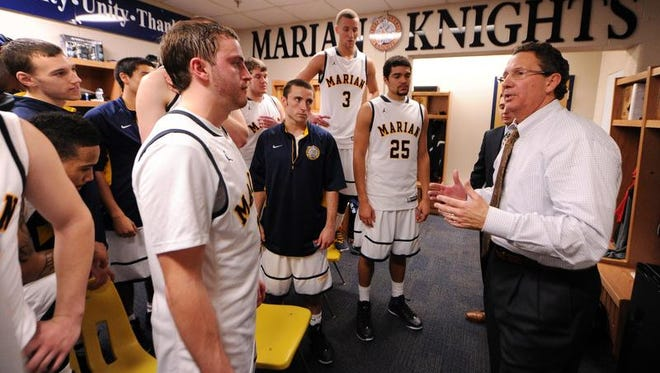 Marian University head basketball coach Todd Lickliter speaks to his team following their victory over Bethel College inside the teams locker room, January 11, 2014, in Indianapolis. Twenty-fourth ranked Marian University defeated fourth ranked Bethel College 77-70.