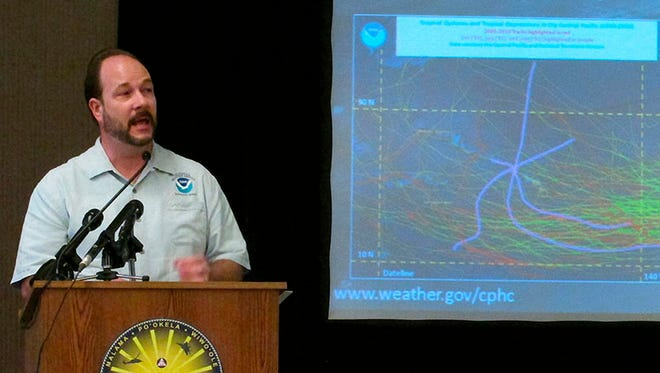 Acting Director Tom Evans of the Central Pacific Hurricane Center speaks during a briefing in Honolulu on Wednesday, May 21, 2014. Weather forecasters are predicting four to seven tropical cyclones in the central Pacific Ocean during this year's hurricane season.