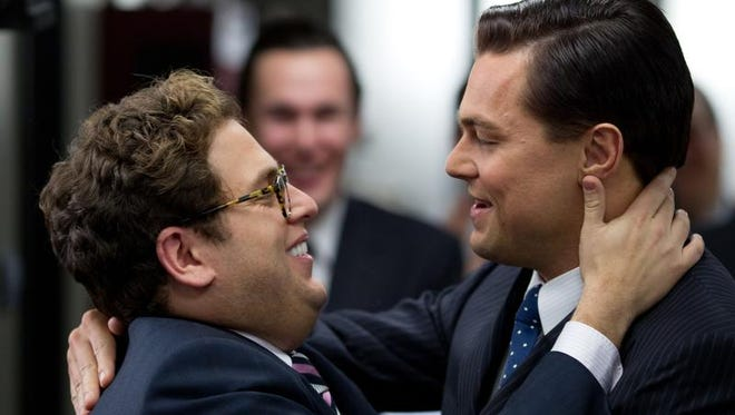 """Jonah Hill (left) and Leonardo DiCaprio in a scene from """"The Wolf of Wall Street."""""""