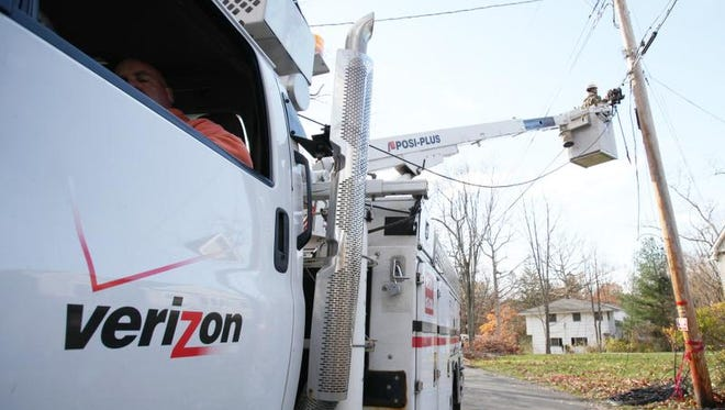 Verizon crews restore fiber-optic lines on Glen Brook and  Forshay roads in Pomona on Monday, Nov. 5, 2012.