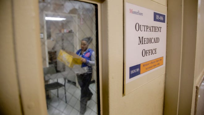 A Medicaid office employee works on reports at Montefiore Medical Center in New York City on Nov. 21.