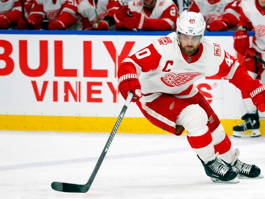 FILE - In this March 29, 2018, file photo, Detroit Red Wings forward Henrik Zetterberg (40) tips the puck during the second period of an NHL hockey game against the Buffalo Sabres, in Buffalo, N.Y. Technology is available to track how fast players are skating, how hard they're shooting and how quickly they're getting the puck from end to end. Zetterberg is not a fan of the NHL generating data on the speed of the game, saying it would be used against players by teams when negotiating contracts.(AP Photo/Jeffrey T. Barnes, File)