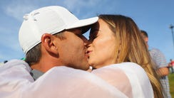 Brooks Koepka kisses girlfriend Jena Sims after winning