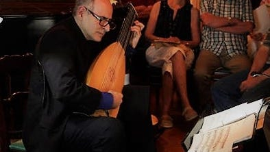 Viewers can see William Simms playing the theorbo in the YouTube presentation from the Winchendon Music Festival.