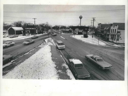 Highway 83, which runs north and south through downtown Mukwonago, altered the village square over the years. This 1975 photo looks north, with 83 to the right, and Highway ES to the left.