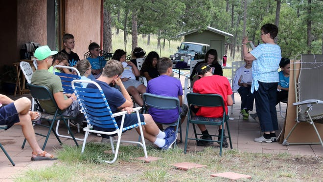 Kathy Golightly, an experienced teacher of conflict resolution, leads a session at the 13th annual Peace Village camp last week.