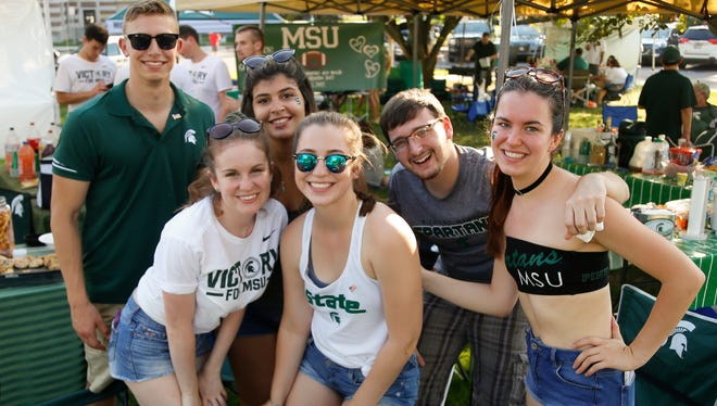 Football fans tailgate Saturday afternoon, Sept. 23, 2017, before MSU meets Notre Dame for the 8 p.m. kickoff.