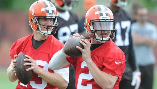 Browns QBs Johnny Manziel and Josh McCown (13) work out on the field Tuesday.