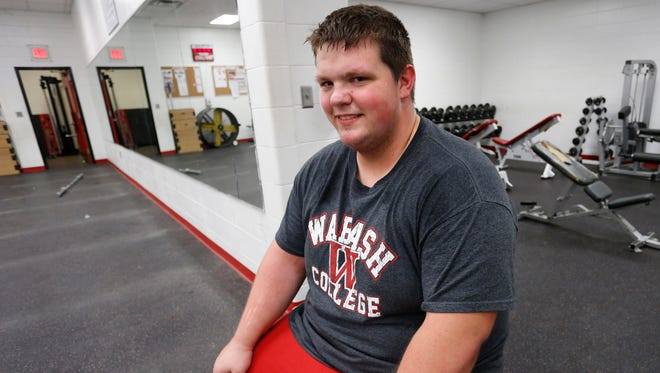 Colton Page catches his breath after working out in the weight room Friday, May 13, 2016, at Lafayette Jeff. A Lilly Scholar, Page will attend Wabash College and play football.