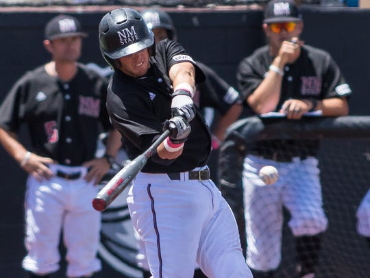 New Mexico State's Trey Stine keeps his eyes on the