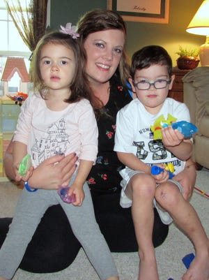 Heather Mastrantonio sits with her two children, Izadora, 2, and Enzo, 4. Enzo has a rare and serious genetic disorder that affects balance and impulse control.