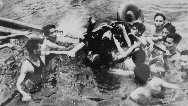North Vietnamese remove Navy flier John McCain from the waters off the Vietnamese coast after McCain's plane was shot down in 1967 while on a bombing mission. McCain, now a U.S. senator, was held captive from 1967 until 1973. The photo is among those released by the Library of Congress and taken by North Vietnamese photographers during the war.