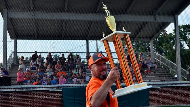 Northeastern head coach Ken Kopp holds up the York-Adams American Legion championship trophy in  2015. Kopp is hoping to lead his team to another Legion crown this season.