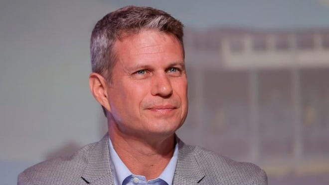 Rep. Bill Huizenga, R-Mich., is seen during a congressional panel at the 2016 Mackinac Republican Leadership Conference in Mackinac Island, Mich. Huizenga cited a decision to delay treatment of his son's broken arm as an example of the kind of choices Americans would face if Republicans' repeal of the health care law shifts more out-of-pocket costs to consumers.