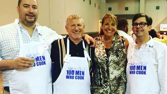 Cooks from left: Ben Franz, Mike Padgett, Angie Padgett and Matt Rowe enjoy an evening of camaraderie and great food at the 2016 100 Men Who Cook.