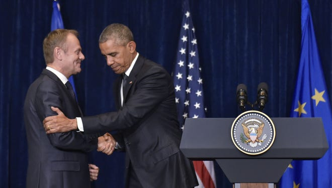 President Obama shakes hands with European Council President Donald Tusk following a meeting on the sidelines of the NATO Summit at a hotel in Warsaw Friday. The Polish capital hosts a two-day NATO summit, the first time ever that it hosts a top-level meeting of the Western military alliance which it joined in 1999.