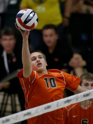 Kaukauna's Zach Schmidt taps a ball during the State volleyball championship game against Kettle Moraine at Wisconsin Lutheran College, in Milwaukee, Saturday, Nov 14, 2015. (Jeffrey Phelps for Post Crescent Media.)