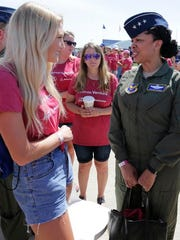 Air Force Lt. Gen. Stayce Harris talks with Ellie Gall of Morgantown, West Virginia, Wednesday, July 25, 2018, in Oshkosh.