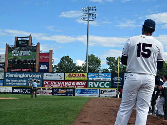 The Somerset Patriots' Matt Fields watches as the team puts a video presentation on the scoreboard to mark his retirement Sunday.